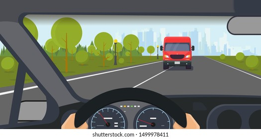 Danger on the road. Danferous incident on the highway. Inside car view. Modern car interior with steering wheel and hands. Big truck on lane. Highway to big city and solid lane on the road.