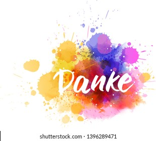 Danke - Thank you in German. Handwritten modern calligraphy lettering text on abstract watercolor paint splash background.