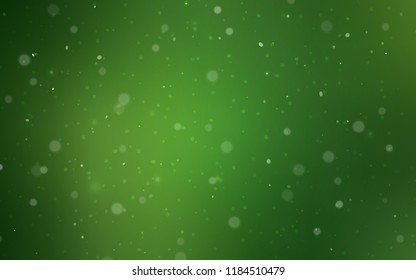 Dark Green vector template with ice snowflakes. Snow on blurred abstract background with gradient. The template can be used as a new year background.
