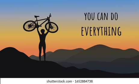 Dark silhouette of a cyclist on top of a mountain. The bike is raised above your head. Against the backdrop of a beautiful morning sky and mountain landscape. You can do everything