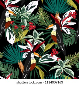 Dark Tropical forest  Colorful Toucan, exotic birds, tropical flowers, palm leaves, jungle leaf, wild flower seamless vector floral pattern background on black