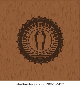 dead man in his coffin icon inside wooden emblem