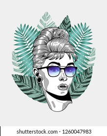 Dec. 17, 2018: Audrey Hepburn. Vector illustration hand drawn. Hipster portrait with glasses and tropical leaves. Summer style.