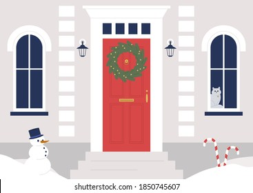 A decorated building entrance, a Christmas wreath on the door, winter holidays