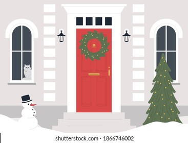 A decorated building entrance, a Christmas wreath on the door, a Xmas tree, winter holidays