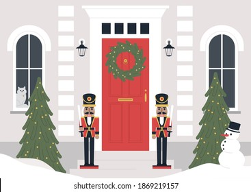 A decorated building entrance, a Christmas wreath on the door, a Xmas tree, nutcracker statues,  a winter holiday concept
