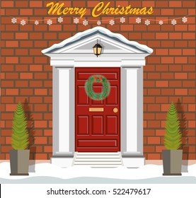 Decorated Christmas door with snow, Christmas wreath and lantern.Orange brick wall. Flat style vector illustration.