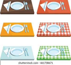Decorated wooden, plastic and metal table with red and green tablecloth, plates, cutlery and napkin