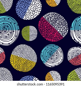 Decorative abstract polka dots in the style of the 60s.  Cheerful polka dot vector seamless pattern. Can be used in textile industry, paper, background, scrapbooking.