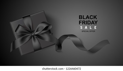 Decorative black gift box with long ribbon on black background. Black friday sale design template. Vector illustration