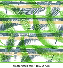 Decorative coconut palm leaves tree branches overlaying stripes vector seamless pattern. Madagascar jungle foliage beach fashion fabric print. Tropical leaves silhouettes wallpaper.