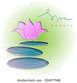 Decorative colored background with spa stones and flower