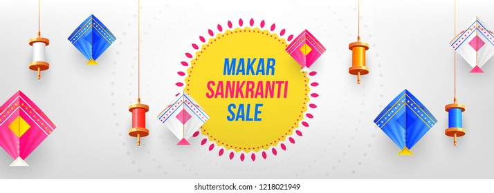 Decorative colorful spools and kites on glossy gray background for celebration of Makar Sankranti festival. Website header or banner design.
