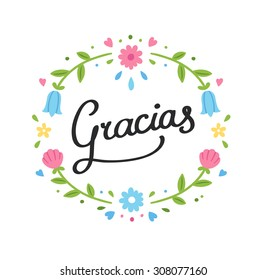 """Decorative handwritten Gracias sign (""""Thank You"""" in Spanish) with simple and cute floral wreath."""