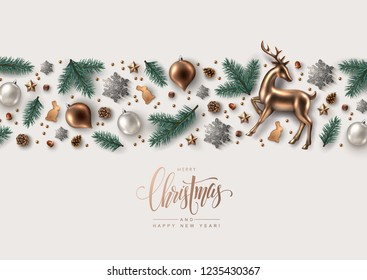 Decorative Horizontal Border made of Christmas Ornaments, Pine Branches, Snowflakes, Cookies and Gold Glass Reindeer.  Flat lay, top view.