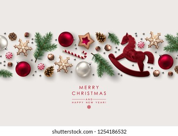 Decorative Horizontal Border made of Christmas Ornaments, Pine Branches, Snowflakes, Cookies and Candy Canes. Flat lay, top view.