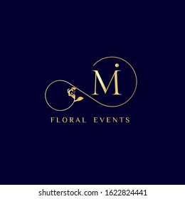 """Decorative """"Mi"""" monogram with calla lily. Elegant luxurious logo design for cosmetics and beauty business. Golden color on dark blue background."""