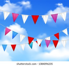 Decorative outdoor party slingers pennants red white pink against blue cloudy sky realistic closeup image vector illustration