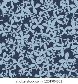 Decorative seamless pattern with chaotic small blue flowers. Endless floral ornament with blue acosmic flowers on dark blue backdrop. Stylish background for fabric, wrapping, decoration.