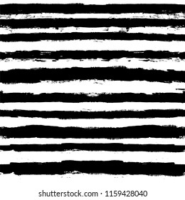 Decorative seamless pattern with hand drawn striped shapes. Hand painted lines grunge ink doodles in black and white colors. vector stripes graphic background. brush strokes, paintbrush backdrop