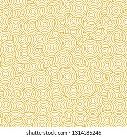 Decorative seamless pattern with hand drawn concentric golden mustard yellow circles. Elegant pattern in Japanese style for fashion, interior design.