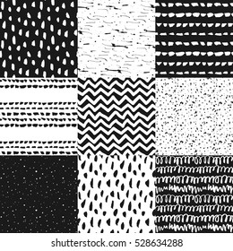 Decorative seamless pattern with handdrawn shapes. Hand painted grungy black ink doodles on white background. Trendy endless texture for digital paper, fabric, backdrops, wrapping