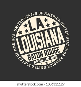 Decorative stamp on black background with postal abbreviation LA, state name Louisiana, capital Baton Rouge and date become a state April 30, 1812 with text United State of America around it.