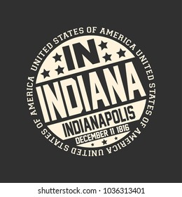 Decorative stamp on black background with postal abbreviation IN, state name Indiana, capital Indianapolis and date become a state December 11, 1816 with text United State of America around it.
