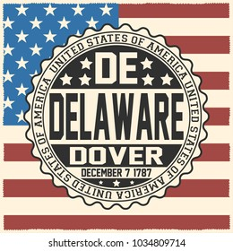 Decorative stamp with text United States of America, DE, Delaware, Dover, December 7, 1787 on USA flag.