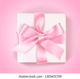 Decorative white gift box with pink bow and ribbon on pink background. Vector illustration. Holiday decoration