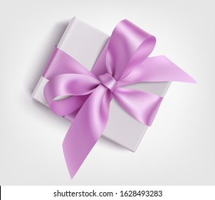 Decorative white gift box with purple bow for holiday decoration. Vector illustration