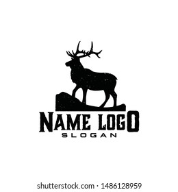 Deer elk moose with rock climb hills logo vector. strong gentle elegant look brand hand drawn vintage for icon profile photo adventure outdoor hunt cloth apparel classic old studio photo video.