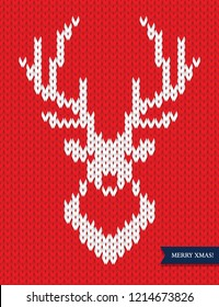 Deer head knitted pattern on red background. Winter fashion, Christmas symbol. Greeting card or banner design element.