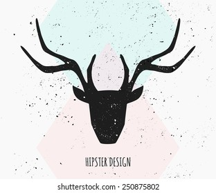 Deer head silhouette in black on an abstract geometric background in pastel colors.