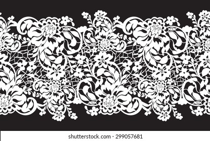 Delicate white lace with flowers on a black background