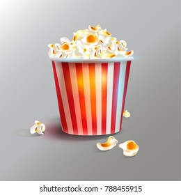 Delicious realistic cinema theater popcorn can, isolated on grey background. Vector illustration.