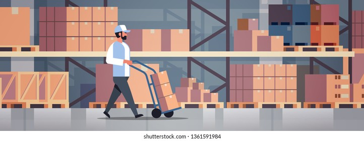 delivery man rolling cardboard box cargo trolley pushcart courier carrying parcels on hand truck warehouse room interior flat horizontal banner