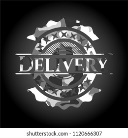 Delivery on grey camouflaged texture