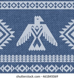 Denim background with abstract eagle and ethnic pattern