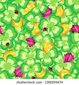 Dense seamless pattern of shamrocks, clover flowers and gold coins mixed with them on St. Patrick's Day.
