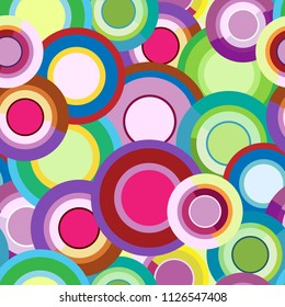 Dense vector seamless pattern of bright and colored circles and rings