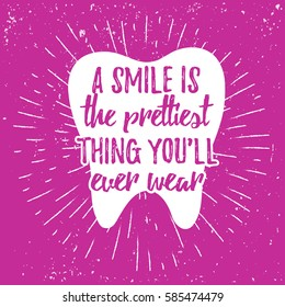Dental care motivational quote poster. Dentist Day greeting card template. Typography lettering design on a tooth shape grunge texture and sunburst for print, t-shirt. Smile is the prettiest thing