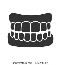 Dentures glyph icon. False teeth. Human jaw with teeth model. Silhouette symbol. Negative space. Vector isolated illustration