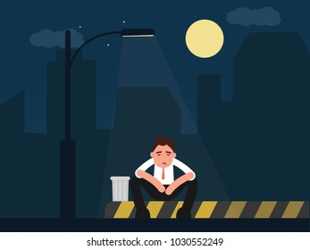 Depressed businessman sitting with street lamp on of the night city