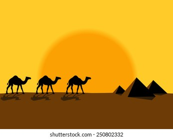 Desert evening landscape with the camels and pyramids