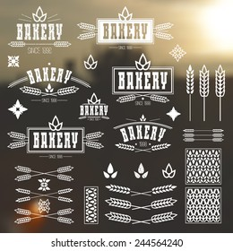 Design elements and logo for bakery. White print on a blurred background