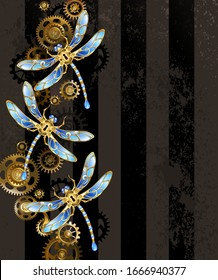 Design with mechanical, golden dragonflies, decorated with blue, glass wings with gold and brass gears on striped, textured, brown background. Steampunk style.