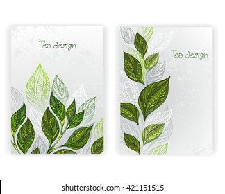 Design with patterned, green and gray leaves of tea on textural background.