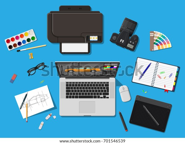 Designer workplace. Illustrator desktop with tools. Laptop pc, photo camera, mouse, glasses, notes, pen, printer. Sketch on paper blank and graphic tablet. Vector illustration in flat style