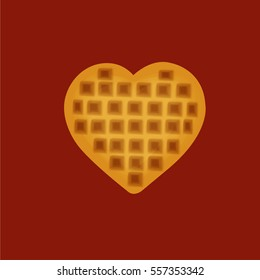 Dessert waffle heart yellow on a red background.